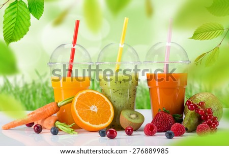 Fresh juice mix fruit, healthy drinks on white table. - stock photo
