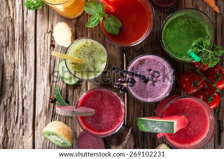 Fresh juice mix fruit, healthy drinks on wooden table. - stock photo