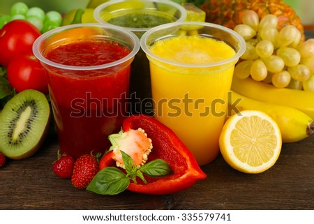 Fresh juice mix fruit, healthy drinks on wooden table background - stock photo