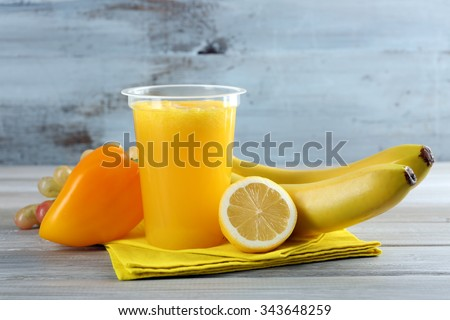 Fresh juice mix fruit, healthy drinks on wooden table, on bright background - stock photo