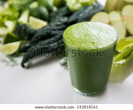 Fresh Juice Smoothie Made with Organic Fruits, Greens and Limes - stock photo