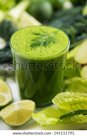 Fresh Juice Smoothie Made with Organic Greens, Apples, Cucumbers, and Limes - stock photo