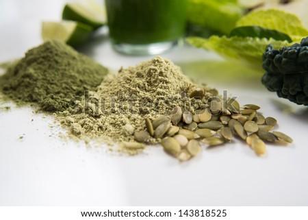 Fresh Juice Smoothie Made with Organic Greens, Spirulina, Pumpkin Protein Powders - stock photo