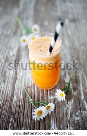 Fresh juice with carrot, apple, gingr and orange - stock photo