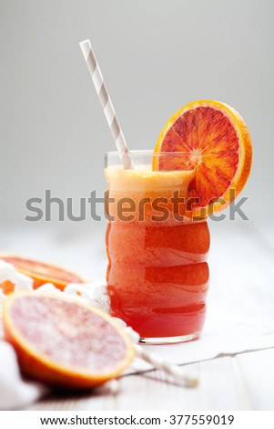 Fresh juice with carrot, blood orange and ginger - stock photo
