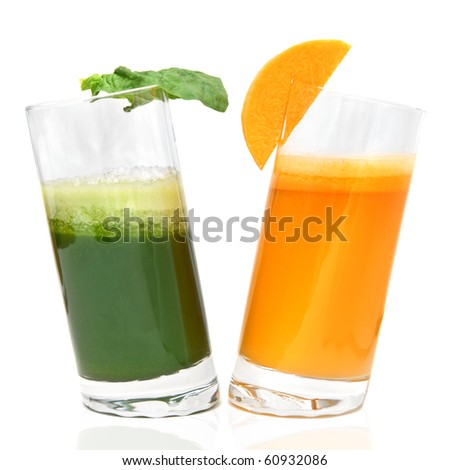 fresh juices from carrot and parsley in glasses isolated on white