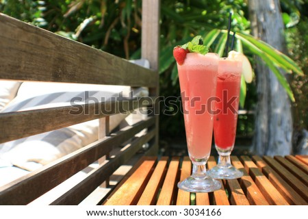 Fresh juices next to a day bed ready to be consumed! - stock photo