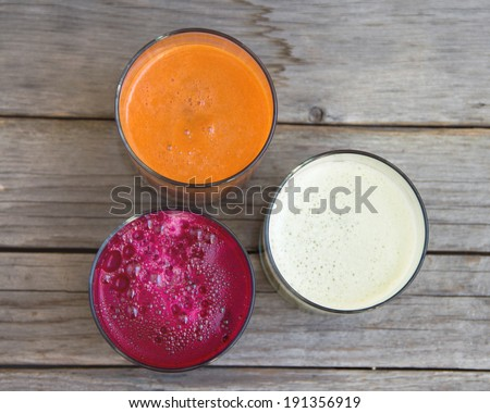 Fresh  juices - red beet, cabbage and carrot - stock photo