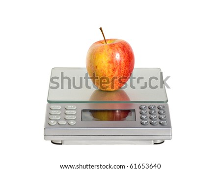 fresh juicy apple being weighed as part of a healthy, calorie controlled diet, isolated on white - stock photo