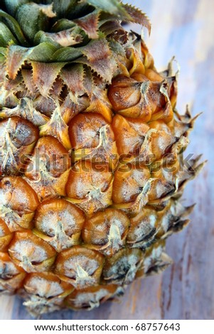fresh juicy big pineapple on a brown background - stock photo