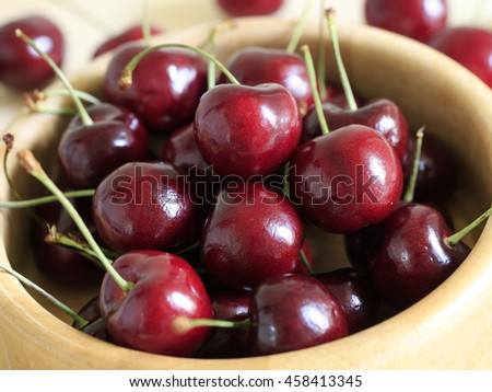 fresh juicy cherries in a wooden bowl.Selective focus