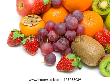 fresh juicy fruits and berries close-up on a white background. Top view. - stock photo