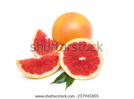Fresh juicy grapefruits with green leafs isolated on white background - stock photo