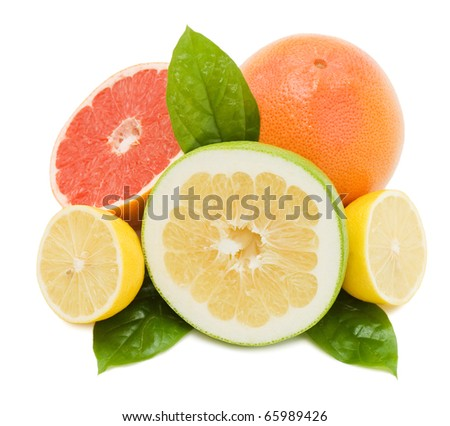 Fresh juicy grapefruits with green leafs. Isolated on white background - stock photo