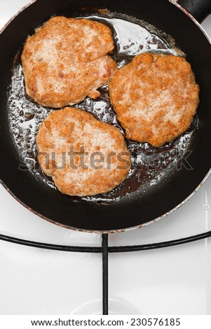 Fresh juicy grilled meat patties in a frying pan - stock photo