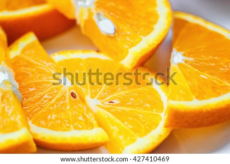 Fresh juicy orange fruit slice isolated. Citrus fruit-natural vitamin C. Studio photography. - stock photo