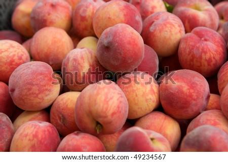 Fresh juicy peaches in the box - stock photo
