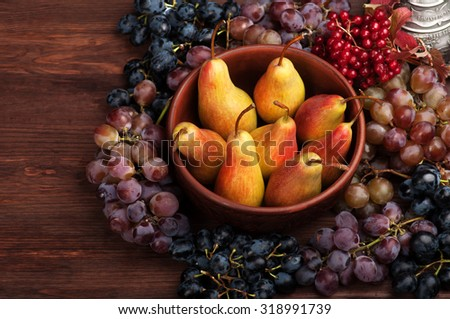 Fresh juicy pear, Pears on a clay plate, autumn still life, grapes, flowers, fall menu, juicy, fresh, vegan, organic food, viburnum, harvesting, harvest, crop, gather, plant, Autumn background - stock photo