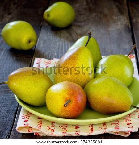 Fresh juicy pears on a table in a rustic style - stock photo