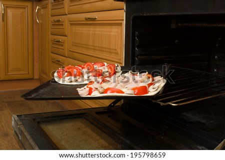 fresh juicy pizza at various stages of preparation - stock photo