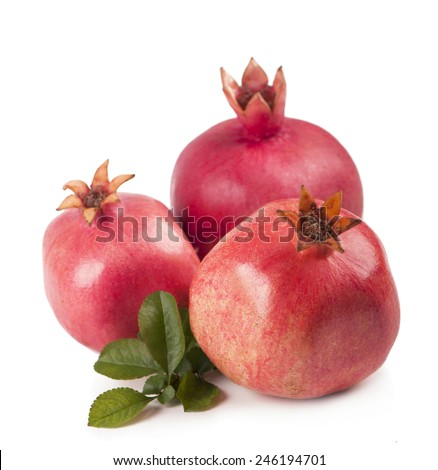 Fresh, juicy pomegranate on a white background - stock photo