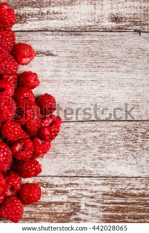 Fresh juicy raspberry on wooden background. Closeup photo. Healthy lifestyle - stock photo