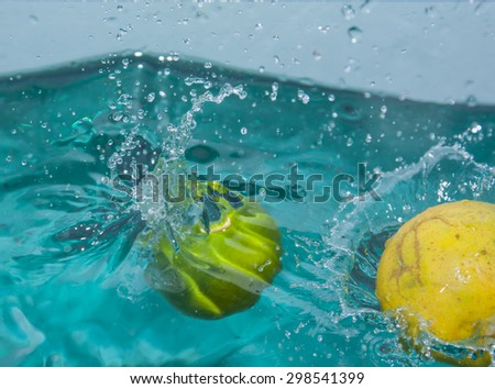Fresh Juicy ripe lemon in the water effect. - stock photo
