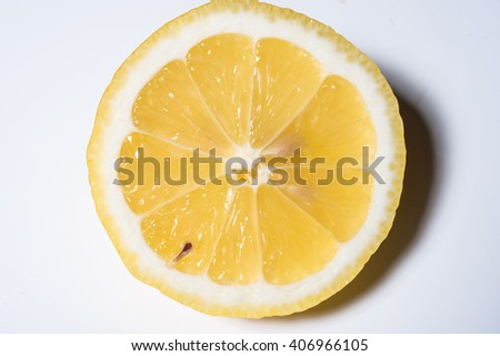 fresh, juicy slice of lemon on white background - stock photo