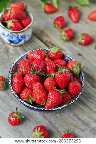 Fresh juicy strawberry in a blue bowl - stock photo