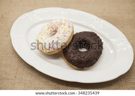 Fresh juicy sweet pastries donuts on a dark background - stock photo