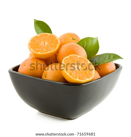 Fresh juicy tangerines in black bowl isolated on white background - stock photo