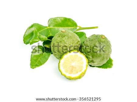 Fresh kaffir lime on a white background. - stock photo