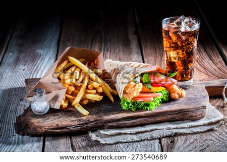Fresh kebab with cod drink and fries - stock photo