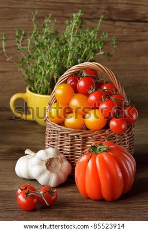 Fresh kitchen garden vegetables in a wicker basket. - stock photo