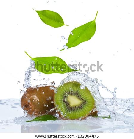 Fresh kiwi and leaf falling in water - stock photo