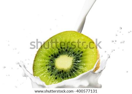 Fresh Kiwi Fruit Fall on Milk Splash - stock photo