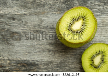 Fresh Kiwi fruit  slices on brown wooden background