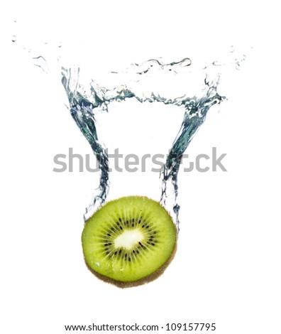Fresh kiwi fruit splashing in the water isolated on white background with bubbles - stock photo