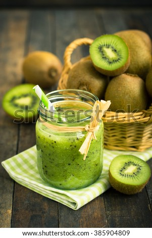 Fresh kiwi smoothie and fruit on the table