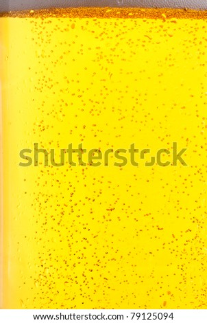 fresh lager beer bubbles close up background - stock photo