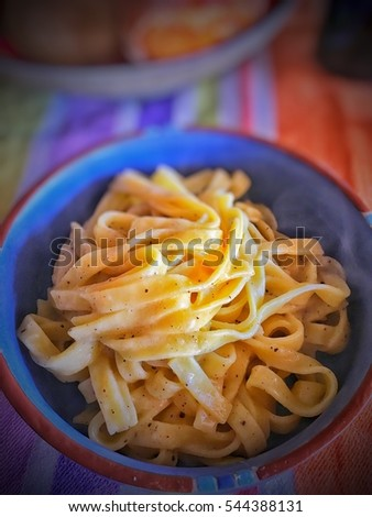 fresh lasagnette pasta with cheeses and pepper , pasta cacio e pepe in vignettes strength.