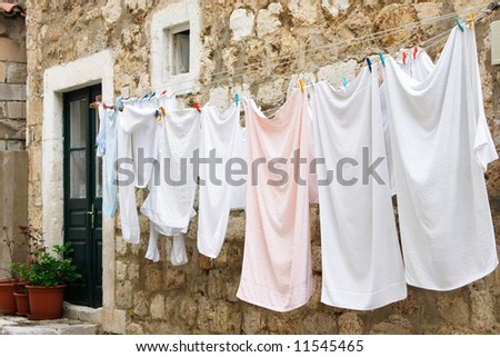 Fresh laundry hanging on a clothesline in downtown (Dubrovnik, Croatia) - stock photo