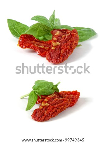 Fresh leaves of basil with dry tomatoes on white background - stock photo