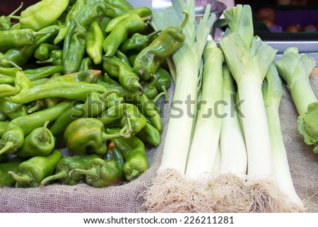 Fresh leeks  and green peppers on a farmer agricultural market - stock photo