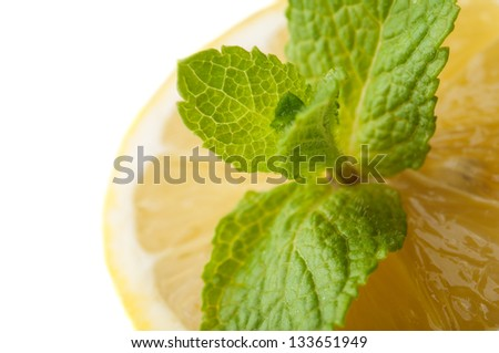 Fresh lemon and green mint isolated on white