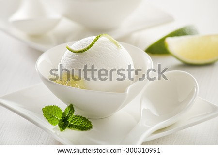 Fresh lemon and lime ice cream in a white cup.