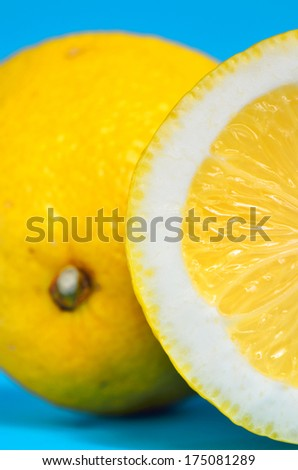 Fresh lemon citrus isolated on blue background, close-up - stock photo