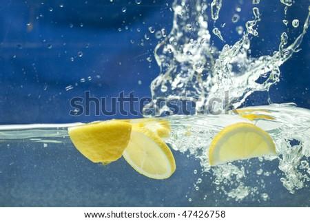 fresh lemon in the water - stock photo