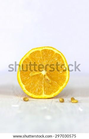 Fresh lemon on a white wooden surface - stock photo