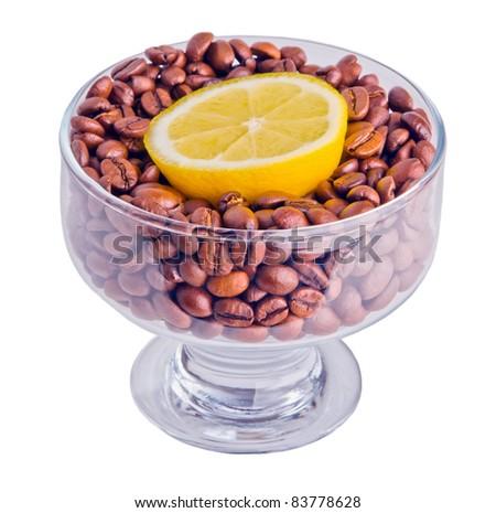 Fresh lemon on coffee beans - stock photo